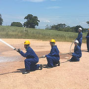 FIRE FIGHTING STUDENTS DEMONSTRATING IN THEIR PRACTICLES