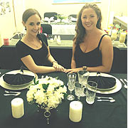 2 OF OUR STEW GIRLS SHOWING OFF THEIR TABLE ARRANGEMENTS AND READY TO TAKE ON THE INDUSTRY.